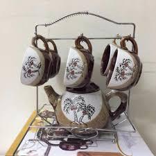 Bộ ấm tách trà có giá treo Aladin